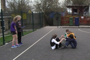 Children at Coton Primary School leading a game of 'All Aboard'